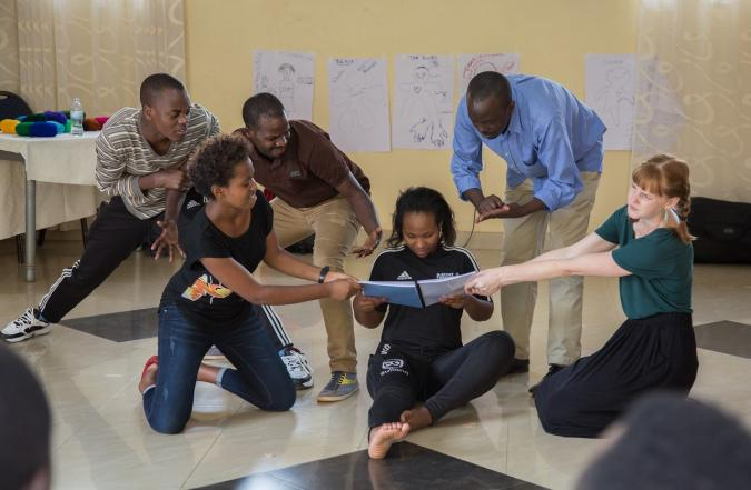 Facilitators working alongside the adult educators to develop drama clubs and to integrate the methodology into schools